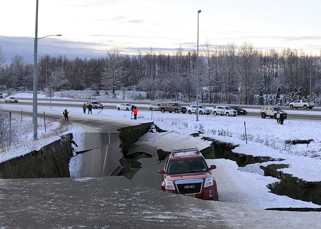 Powerful quakes measuring 7.0 and 5.8 buckle Alaska roads