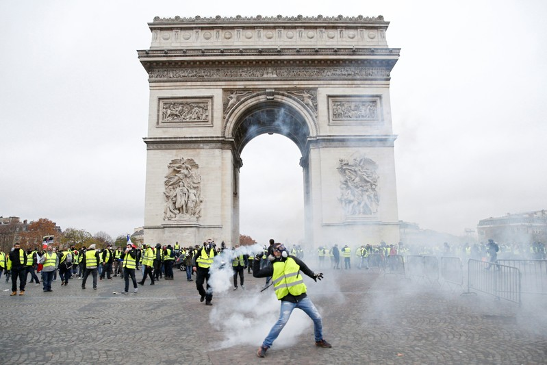 Paris riots: At least 80 injured as police and protesters violently clash