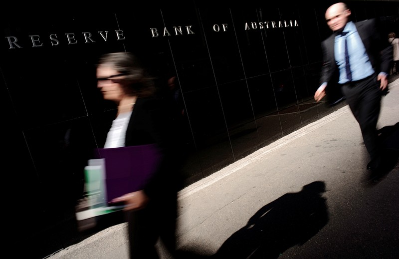 FILE PHOTO - Pedestrians walk past the Reserve Bank of Australia Building in Sydney's central business district
