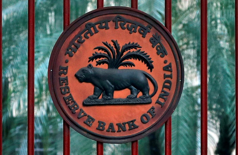 FILE PHOTO: Reserve Bank of India logo is seen at the gate of its office in New Delhi