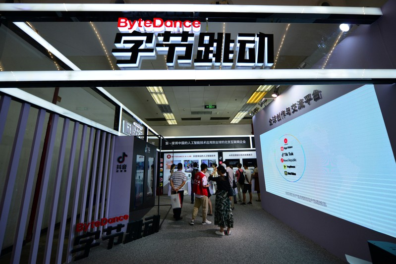 FILE PHOTO - Visitors are seen at the booth of Bytedance Technology at the China International Software Expo in Beijing