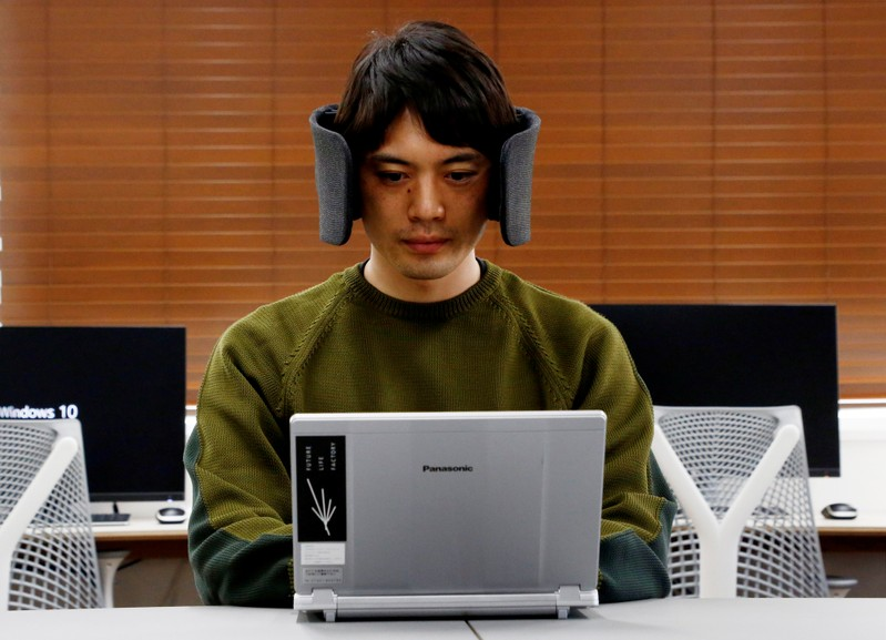 A designer of Panasonic demonstrates a prototype of 'Wear Space' during a photo opportunity in Tokyo