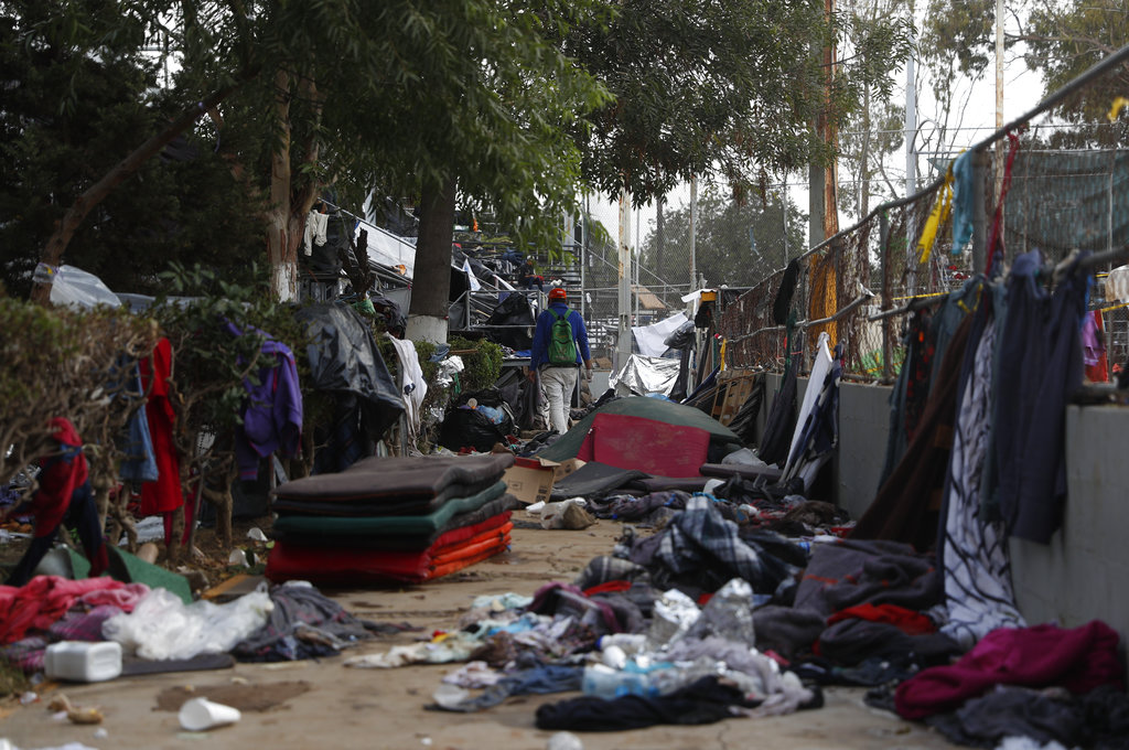 Migrant caravan relocated to new shelter farther from the border