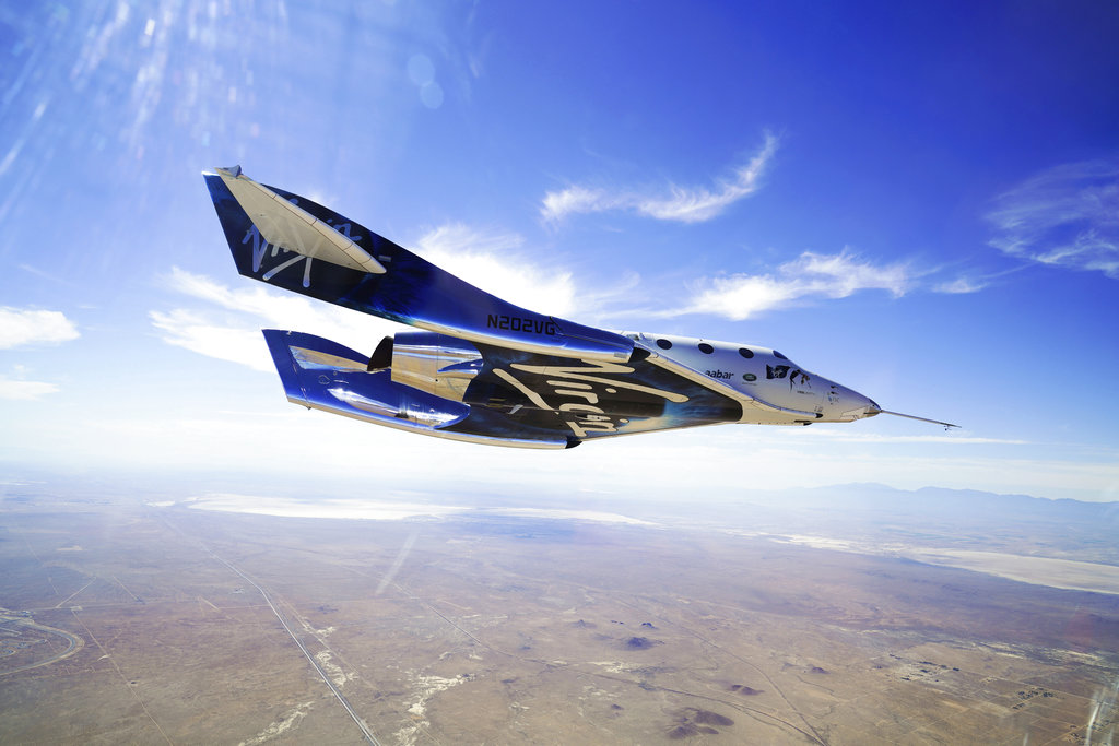 Virgin Galactic plane skims space in historic human test flight