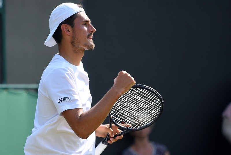 Bizarre ending as Tomic wins first clash against Kyrgios