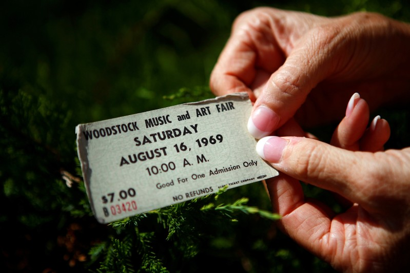 FILE PHOTO: A woman displays her original ticket at the site of the original Woodstock Music Festival in New York