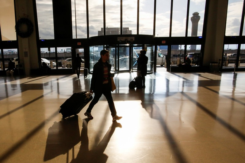 Travelers make their way through Newark Liberty International Airport in Newark, New Jersey