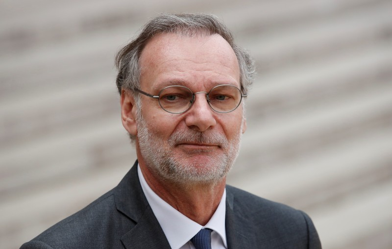 Accenture CEO Pierre Nanterme leaves after the