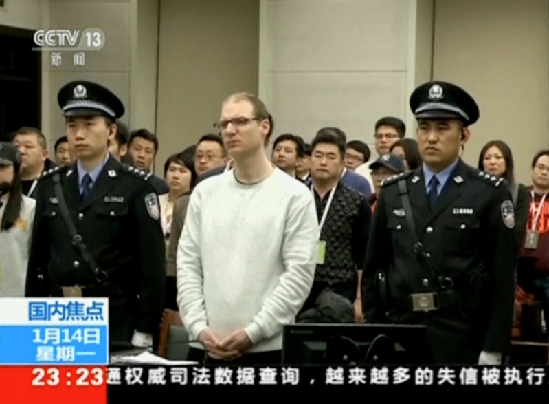 A still image taken from CCTV video shows Canadian Robert Lloyd Schellenberg in court where he was sentenced with a death penalty for drug smuggling in Dalian