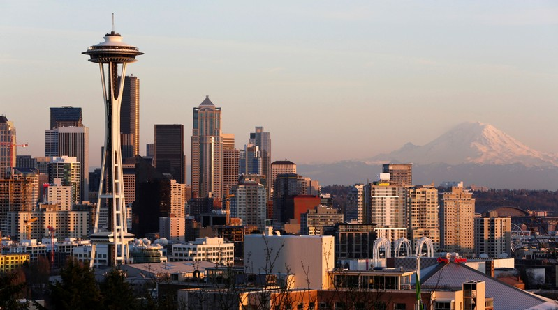 FILE PHOTO: The Space Needle and Mount Rainier are pictured at dusk in Seattle, Washington