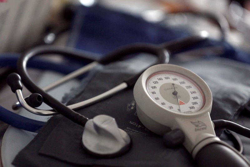 FILE PHOTO: A photo illustration shows a stethoscope and  blood-pressure machine of a French general practitioner displayed in a doctor's office in Bordeaux