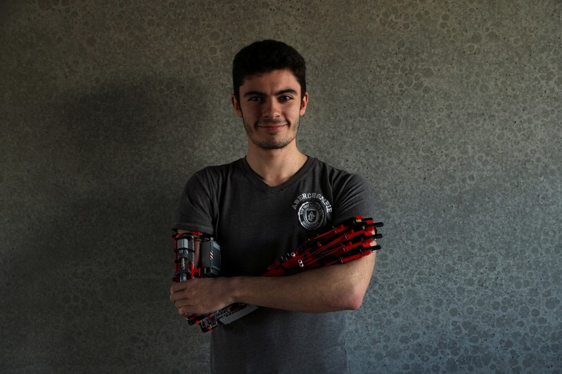 Student builds prosthetic arm using lego pieces