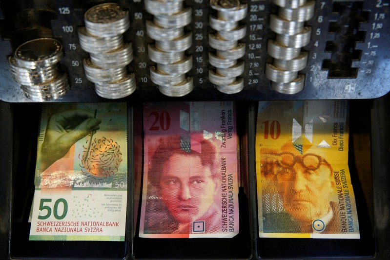 FILE PHOTO - The new 50 Swiss Franc note is seen at a market stall after its release by the Swiss National Bank in Bern