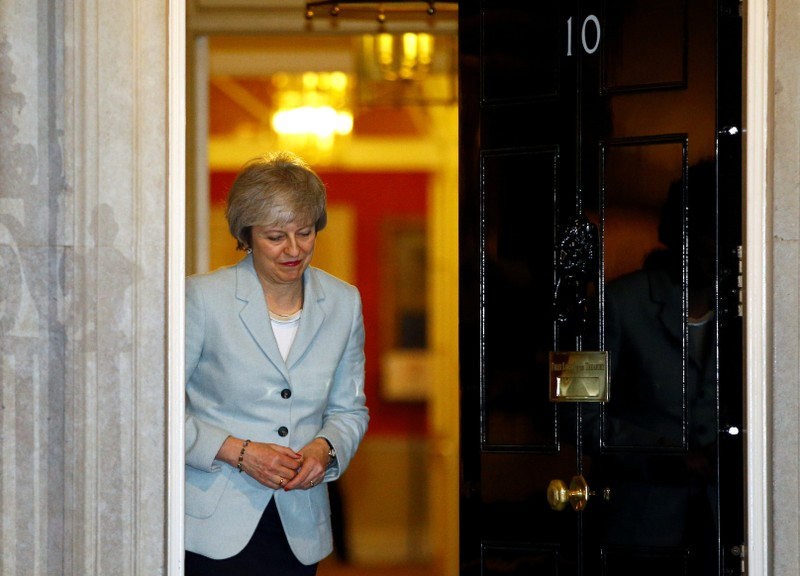 Britain's PM May greets Malta's PM Muscat at Downing Street in London