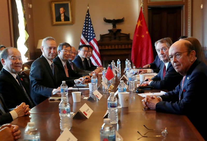 FILE PHOTO: U.S. trade representatives and White House advisers meet with a Chinese delegation led by China's Vice Premier Liu in the Diplomatic Room in the Eisenhower Executive Office Building on the White House campus in Washington