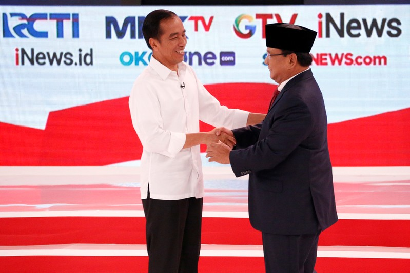 Indonesia's presidential candidate Joko Widodo shakes hands with his opponent Prabowo Subianto after the second debate between presidential candidates ahead of the next general election in Jakarta