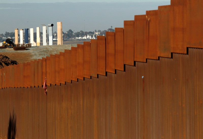 FILE PHOTO: The prototypes for U.S. President Donald Trump's border wall are seen behind the border fence between Mexico and the United States, in Tijuana