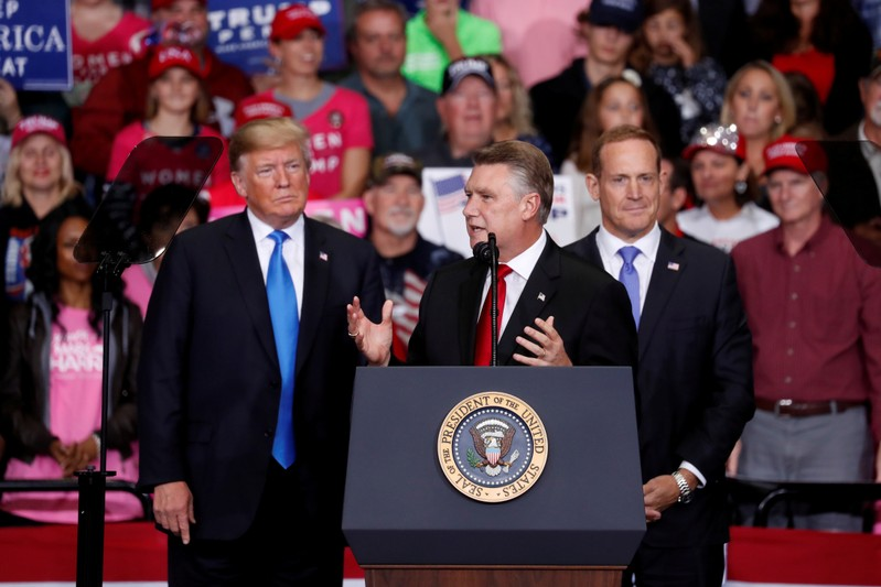 FILE PHOTO: Harris, Republican candidate from North Carolina's 9th Congressional district speaks as U.S. President Trump looks on during a campaign rally in Charlotte
