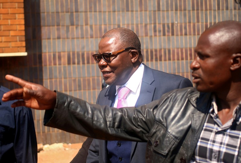FILE PHOTO - Zimbabwe's former finance minister and opposition leader Tendai Biti looks on after appearing at the Magistrate Court in the capital Harare