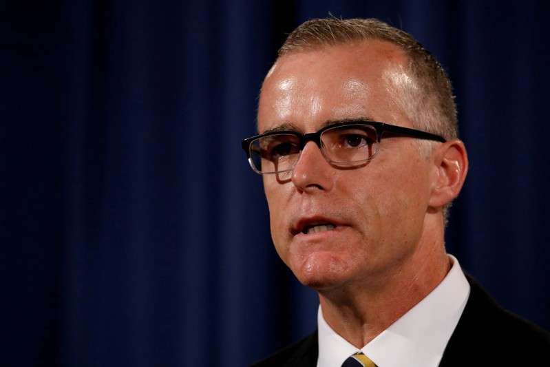 FILE PHOTO: Acting FBI Director Andrew McCabe announces the results of the national health care fraud takedown during a news conference at the Justice Department in Washington