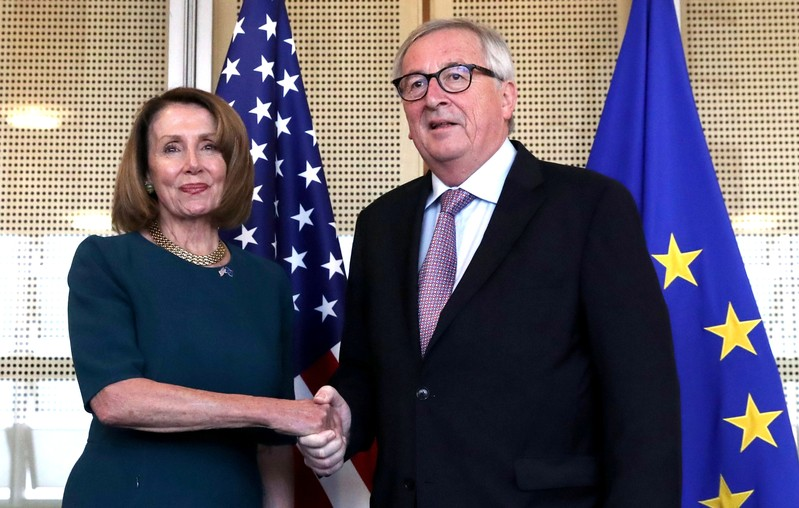 U.S. Speaker of the House of Representatives Nancy Pelosi is welcomed by European Commission President Jean-Claude Juncker at EU Commission headquarters in Brussels