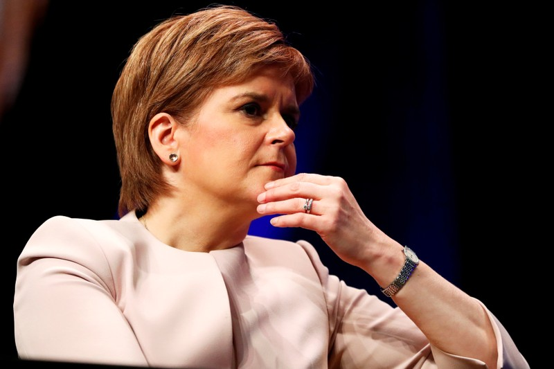 FILE PHOTO: Scotland's First Minister Nicola Sturgeon listens to Plaid Cymru's leader Adam Price speak at the Scottish National Party's party's conference in Glasgow, Scotland
