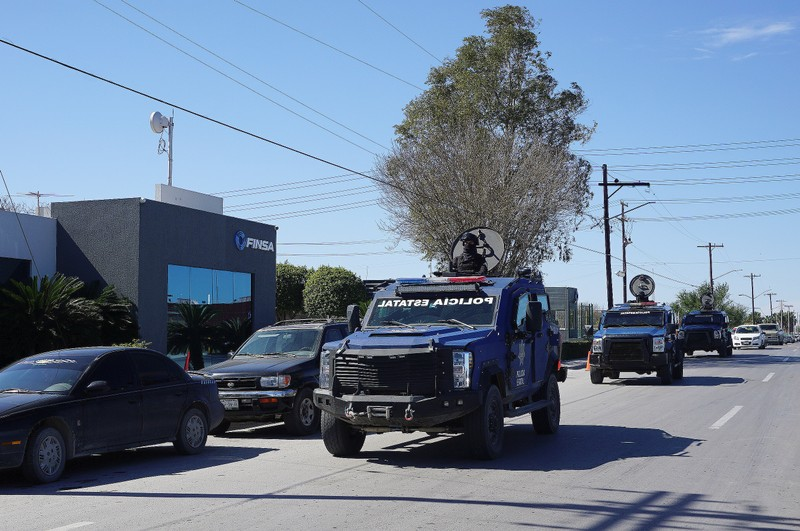 State police armoured vehicles patrol at an industrial park where employees from some plants are on strike in Matamoros
