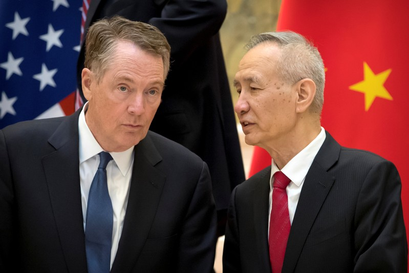 U.S. Trade Representative Robert Lighthizer listens as Chinese Vice Premier Liu He talks while they line up for a group photo at the Diaoyutai State Guesthouse in Beijing