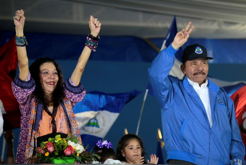 Nicaraguan President Ortega and Vice-President Murillo greet supporters during a march in Managua