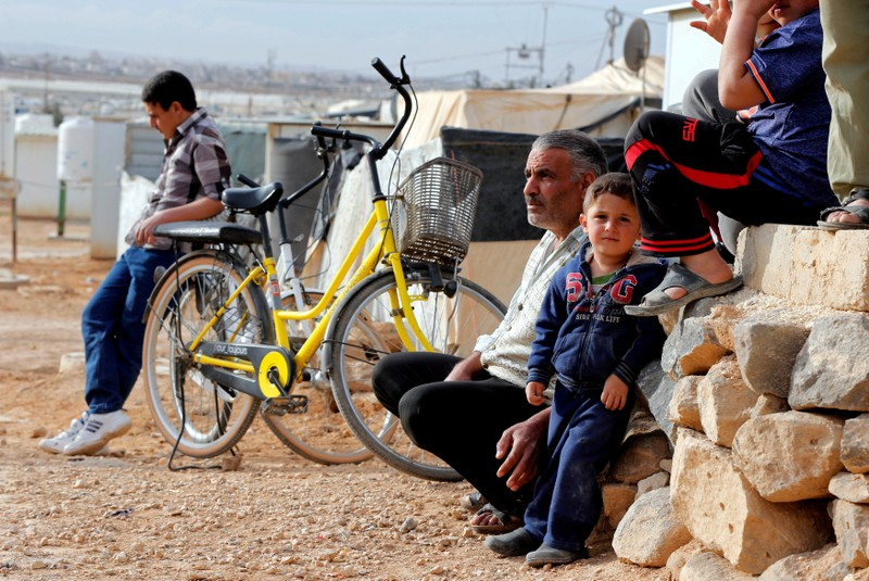 FILE PHOTO: Syrian refugees sit and listen during a news conference by U.N. High Commissioner for Refugees Filippo Grandi at the Al Zaatari refugee camp in Jordan