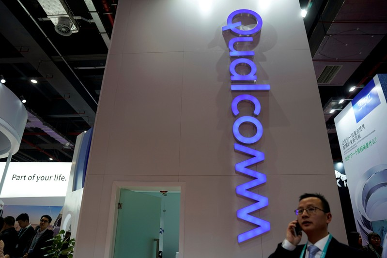FILE PHOTO: A sign of Qualcomm is seen at the China International Import Expo (CIIE), at the National Exhibition and Congress Center of Shanghai,