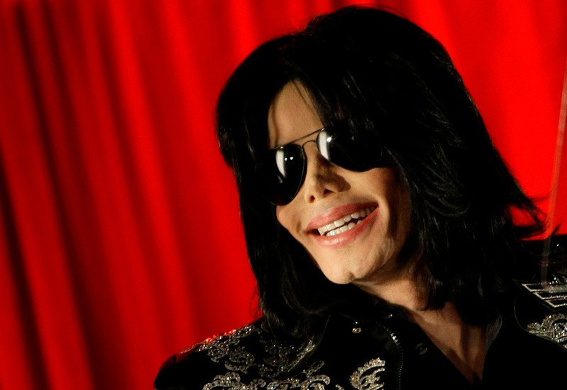 U.S. pop star Michael Jackson gestures during a news conference at the O2 Arena in London