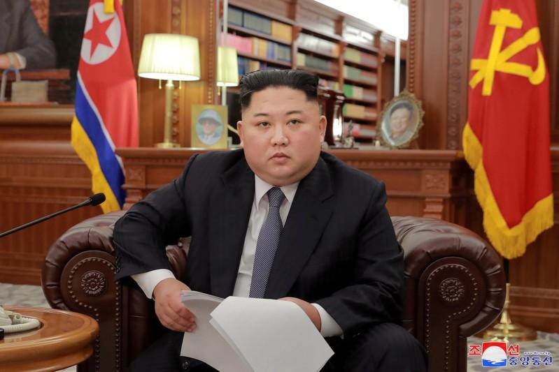 FILE PHOTO - North Korean leader Kim Jong Un poses for photos in Pyongyang