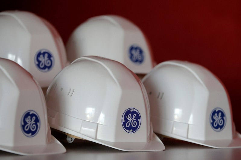 FILE PHOTO: General Electric logo depicted on work helmets during a visit to General Electric offshore wind turbine factory in Montoir-de-Bretagne