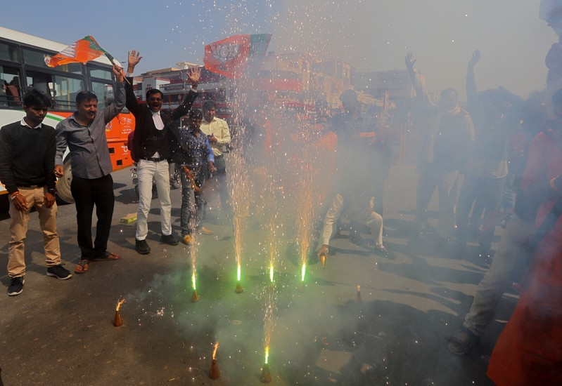 Supporters of India's ruling BJP light fireworks to celebrate after Indian authorities said their jets conducted airstrikes on militant camps in Pakistani territory, in Prayagraj