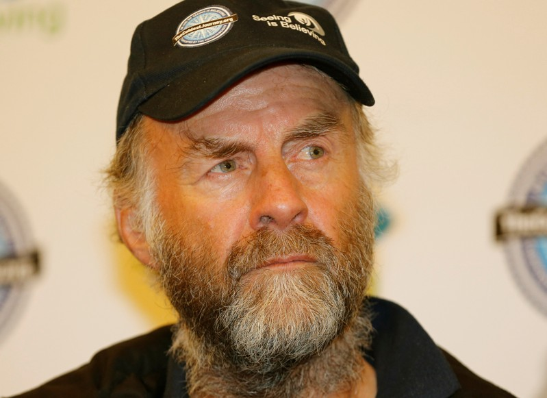 FILE PHOTO: British explorer Ranulph Fiennes listens during a news conference after his arrival at Heathrow Airport in London