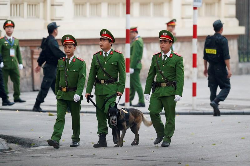 Policemen are seen near the Metropole Hotel ahead of the North Korea-U.S. summit in Hanoi