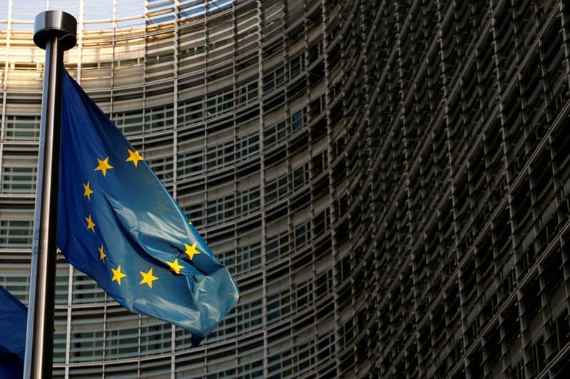 FILE PHOTO: A EU flag is seen outside the EU Commission headquarters in Brussels