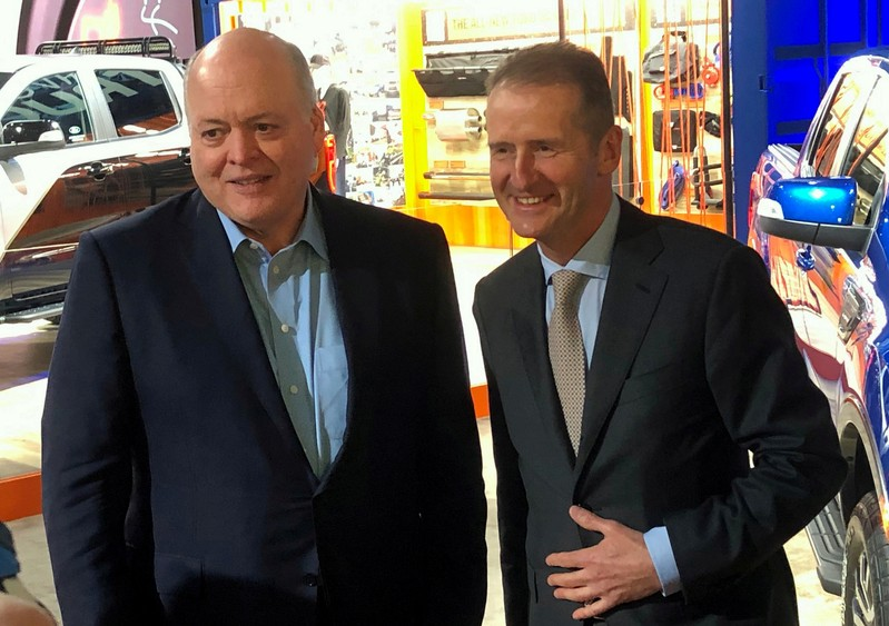 FILE PHOTO: The President and CEO of Ford Motor Company Hackett poses with Volkswagen CEO Diess at the North American International Auto Show in Detroit