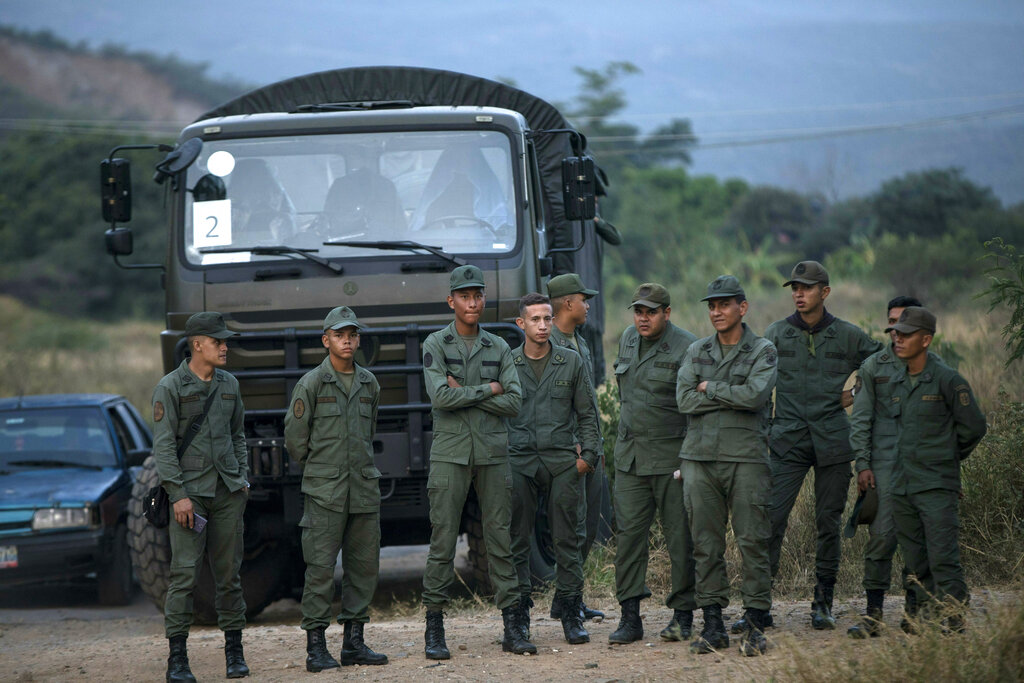 1 killed, 12 hurt in aid standoff on Venezuela-Brazil border