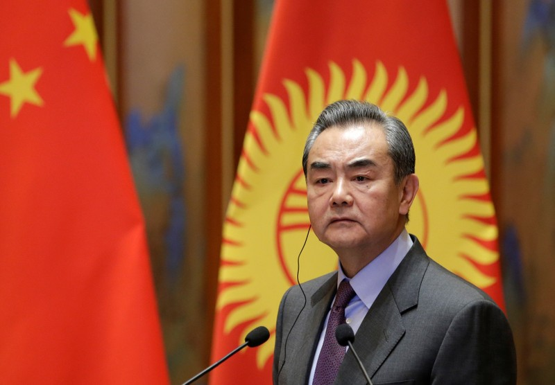 FILE PHOTO: Chinese Foreign Minister Wang Yi attends a joint news conference with Kyrgyzstan's Foreign Minister Chyngyz Aidarbekov in Beijing