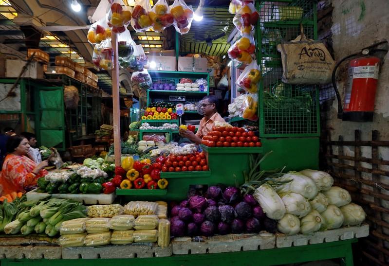 A vendor sells vegetables at a retail market in Kolkata