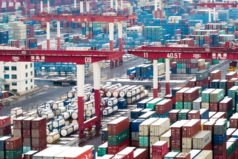 FILE PHOTO: Containers and trucks are seen following a snowfall at the port of Qingdao