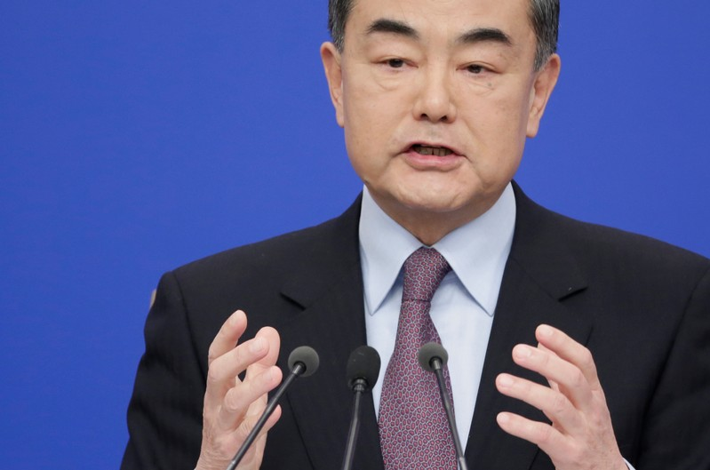 Chinese Foreign Minister Wang Yi attends a news conference during ongoing session of the NPC in Beijing
