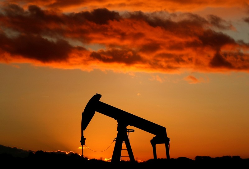 FILE PHOTO: A oil pump is seen at sunset outside Scheibenhard