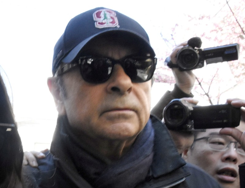 Lawyer sorry for 'tainting' Ghosn's fame with workman disguise