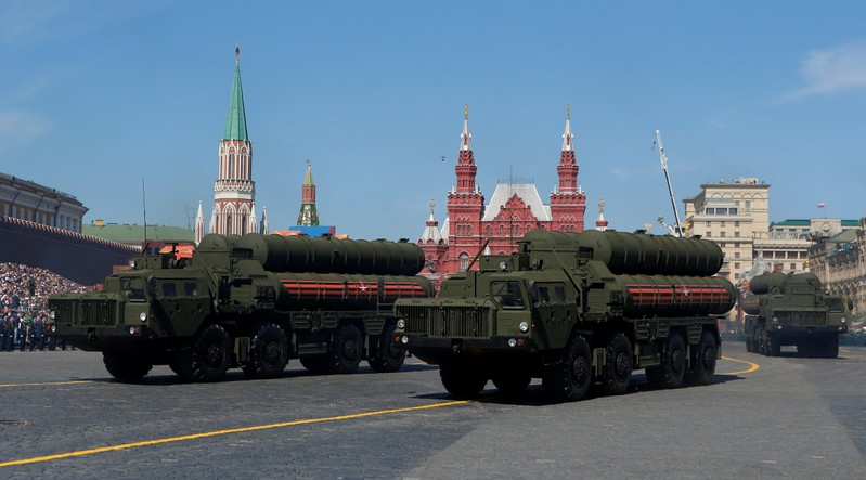 FILE PHOTO: Russian servicemen drive S-400 missile air defence systems during the Victory Day parade at the Red Square in Moscow