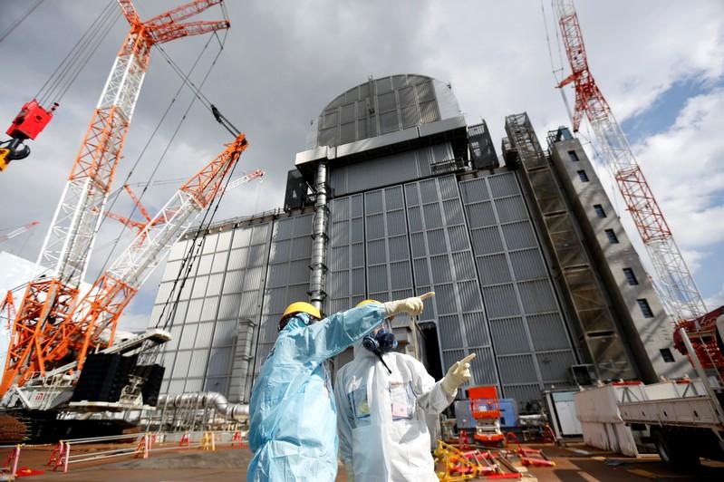 An TEPCO employee gives lectures at tsunami-crippled Fukushima Daiichi nuclear power plant in Okuma town, Fukushima prefecture