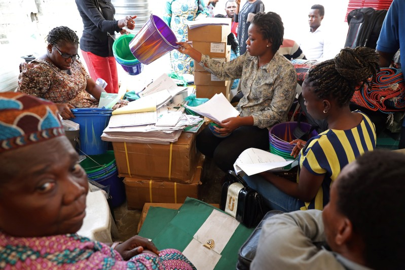 Independent National Electoral Commission (INEC) ad hoc workers sort election materials in Lagos