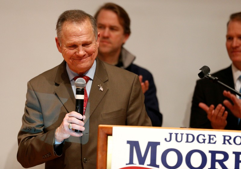 FILE PHOTO: Republican U.S. Senate candidate Roy Moore pauses as he addresses supporters at his election night party in Montgomery